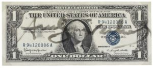 La firma di Warhol sul dollaro.